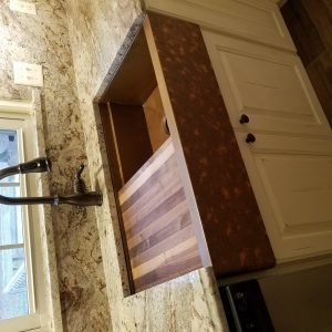 flush copper sink in granite top